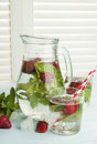 Summer cold drink with strawberry mint and ice on a light backg background Stock Photos