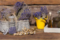 Summer crop of dried lavender poppy seeds and oil on a wooden table in front a garden shed Royalty Free Stock Images
