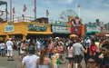 Summer crowd enjoys summer holidays new york s coney island boardwalk amusements vendors Royalty Free Stock Photography