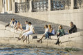 Summer day in st petersburg the group of young people has a rest on neva river embankment sankt Stock Photo