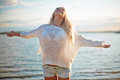 Summer delight delighted blond girl in white pullover and denim shorts enjoying her vacation by the sea Royalty Free Stock Photos