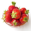 Summer dessert strawberries in bowl against white background Royalty Free Stock Photo