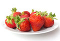 Summer dessert strawberries on plate against white background Stock Photos