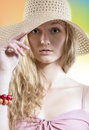 Summer dreamer girl with straw hat on the beach close up portrait of beautiful eyes fresh healthy skin model wearing elegant Royalty Free Stock Photography