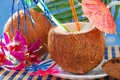 Summer drink in coconut shell fruit served on the beach Royalty Free Stock Photo