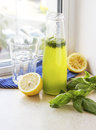 Summer drink with lemon, basil and soda Royalty Free Stock Photo