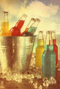 Summer drinks in ice bucket at the beach with vintage look cool Stock Photo