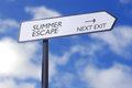 Summer escape street sign with next exit arrow Stock Photos