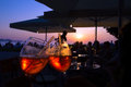 Summer evening orange cocktail in a bar by the sea at the sunset Royalty Free Stock Photo