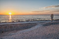 Summer evening in sweden sunset at langhammars on faro island langhammars is famous for its limestone sea stacks called raukar by Royalty Free Stock Photo
