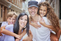 Summer family portrait of parents and kids outside in urban style Royalty Free Stock Photo