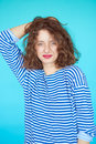 Summer fashion girl with curly hairstyle and striped shirt