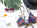Summer Fashion woman bikini, big hat and accessories and sunglasses go to travel in the beach. Tropical sea.Unusual top view, Royalty Free Stock Photo