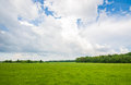 Summer field massive sky scape green clouds Royalty Free Stock Images