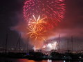 Summer fireworks over boats Stock Photography