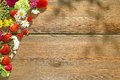 Summer Flowers and Berries on Grunge Wood Table Royalty Free Stock Photo