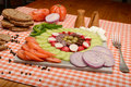 Summer food plate rustic with fresh vegetables sausage and cheese Stock Photo