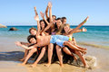 Summer friends group of happy teens at the beach Stock Images