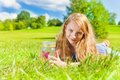 Summer fun games portrait of happy smiling girl with long dark hair years laying in the grass old hold jar with butterfly standing Stock Image