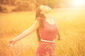 Summer fun young happy woman enjoying sunlight on the wheat meadow Royalty Free Stock Photos