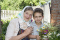 In summer the garden grandmother with her grandson he is holdi on a sunny day a boy holding a bouquet of wildflowers Royalty Free Stock Photos