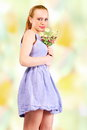 Summer girl flowers cute holding Royalty Free Stock Photos