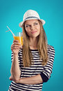 Summer girl in hat pretty straw standing with juice thinking of trip and vacation young attractive blond caucasian female wearing Royalty Free Stock Photography