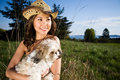 Summer girl with her dog Royalty Free Stock Images