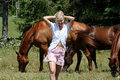 Summer Girl with her horses Royalty Free Stock Images