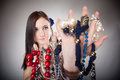 Summer girl plenty of jewellery beads in hands young woman fashion style with collection assorted variety necklaces chains on gray Royalty Free Stock Photos