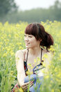 Summer girl in rape field. Royalty Free Stock Photography