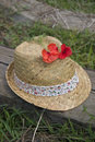 Summer hat and poppy on railway Royalty Free Stock Photography