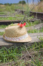 Summer hat and poppy on railway Royalty Free Stock Photos
