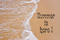 Summer is Here writing on sandy beach Royalty Free Stock Photo