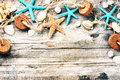 Summer holiday frame with seashells and fishing net Royalty Free Stock Photo