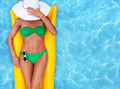 Summer holiday girl sunbathing in a pool Stock Photos