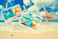 Summer holiday items against a beach scene with vintage effect Royalty Free Stock Image
