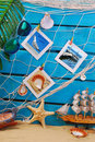 Summer holiday memories with images pinned to the fishing net hanging on blue wooden background Royalty Free Stock Photos