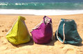 Summer holiday - three vivid bags on the seacoast Royalty Free Stock Photos
