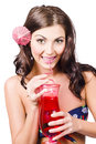 Summer holidays smiling tropical girl drinking red cocktail drink during sweet holiday treat Royalty Free Stock Photos