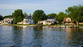Summer home on lake shore in america Stock Image