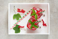 Summer homemade lemonade with red currant, ice and mint on rustic table, with white tray. Copy space, top viewleaf. Royalty Free Stock Photo