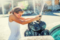 Summer hot day. Cute little girl playing with fountain. Hot weather Royalty Free Stock Photo