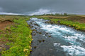 Summer iceland landscape with raging river at overcast weather Royalty Free Stock Photos