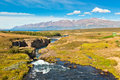 Summer iceland landscape river mountains bright blue sky Royalty Free Stock Images