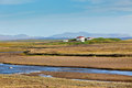 Summer iceland landscape river mountains white farmhouse Stock Images