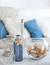 Summer interior decor idea of decoration with starfishes and glass bottles Royalty Free Stock Photos