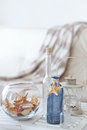 Summer interior decor idea of decoration with starfishes and glass bottles Stock Image