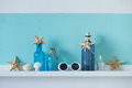 Summer interior decor idea of decoration with starfishes glass bottles and wooden elements Royalty Free Stock Photo