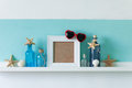 Summer interior decor idea of decoration with starfishes glass bottles and wooden elements Stock Images